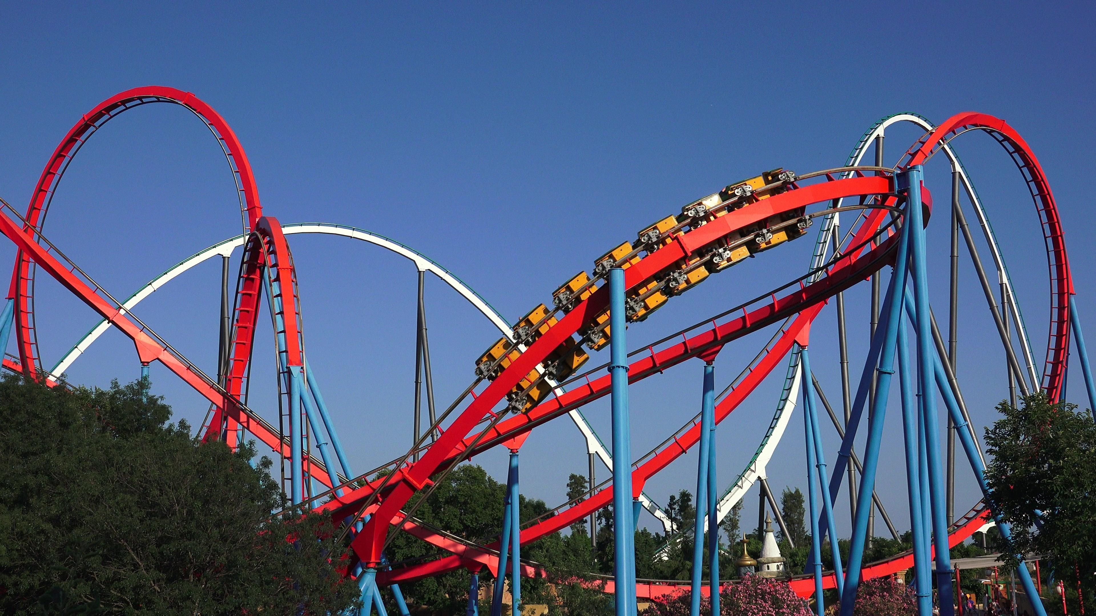 Image result for theme park with roller coaster